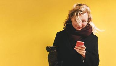 A woman looking at her smartphone.