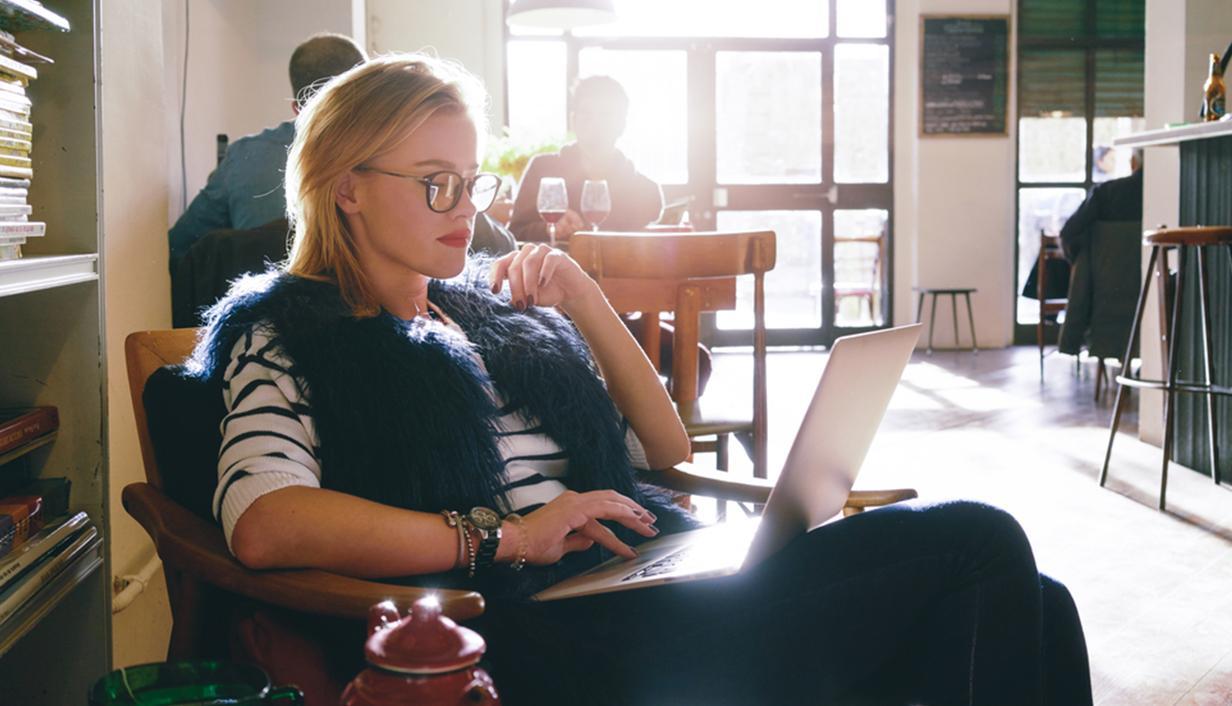 women in cafe on laptop