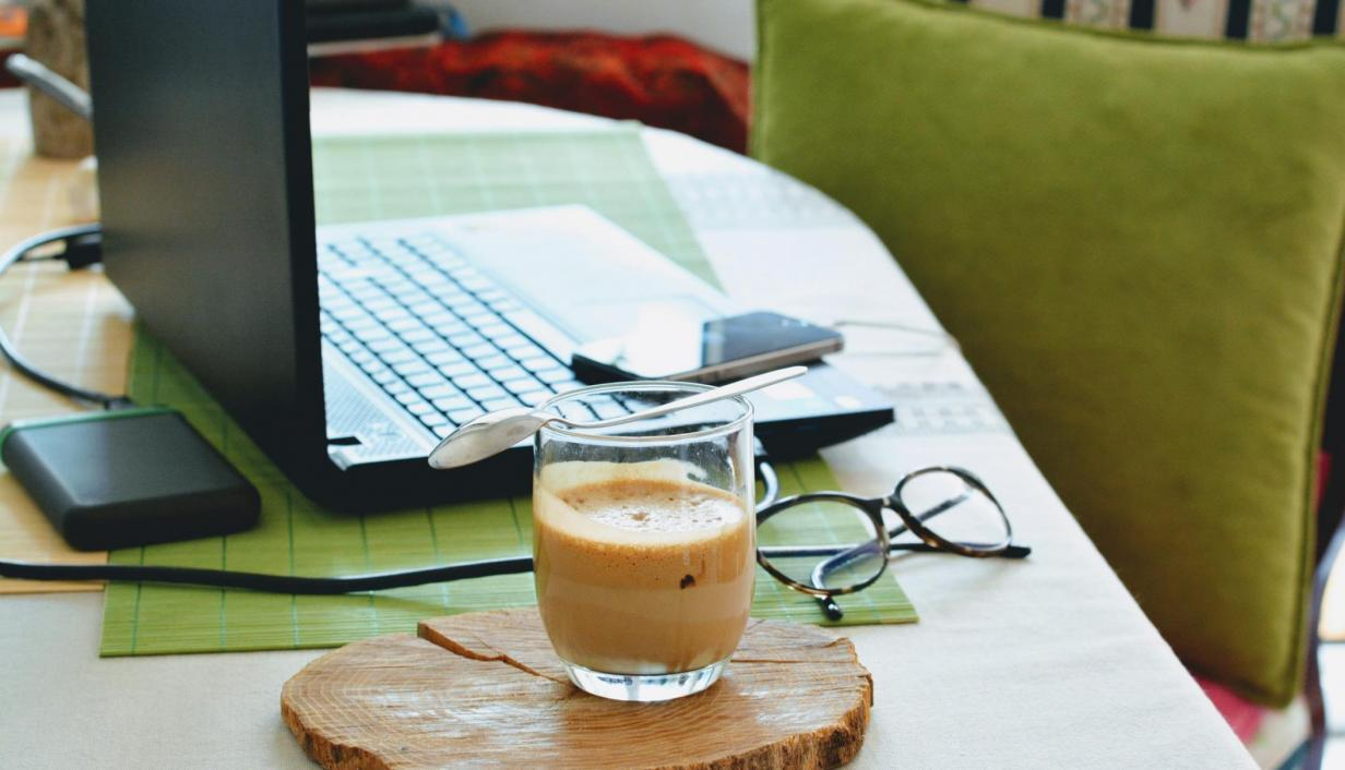 Desk with laptop and coffee