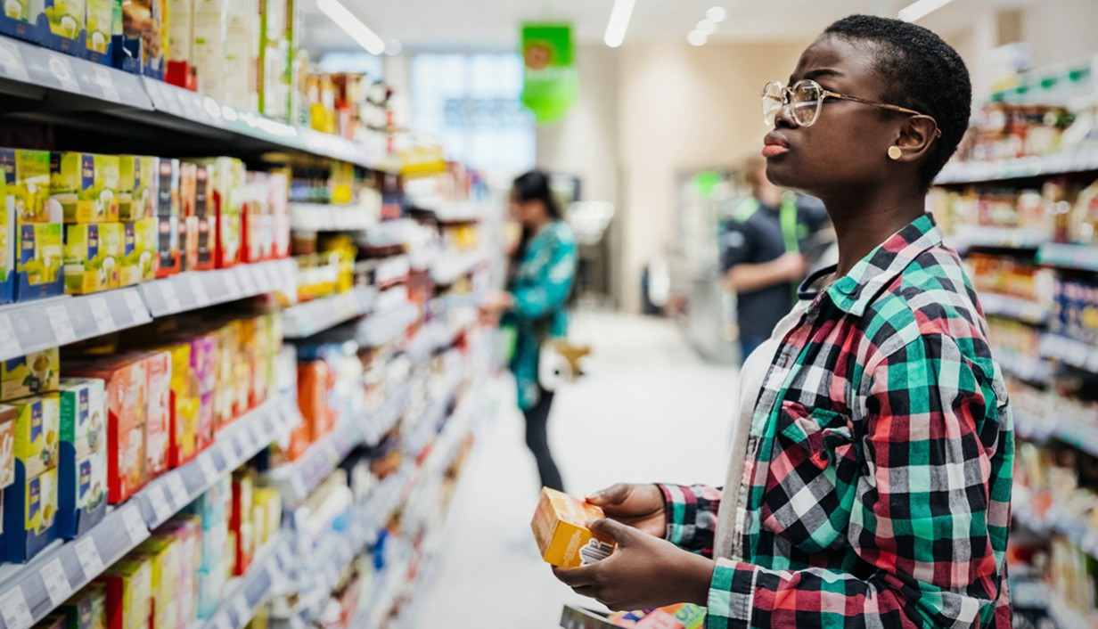 woman looking at products on a store shelf