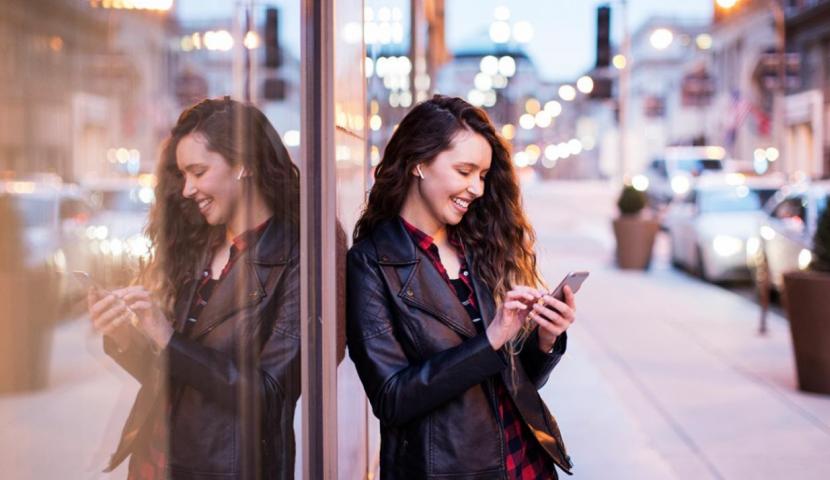 female user using cell phone