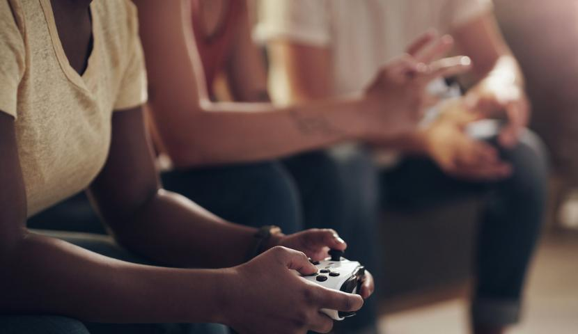 A girl playing with xbox.