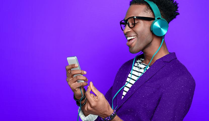 Man listening to headphones on mobile device