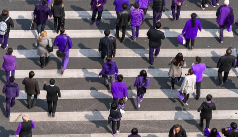 People wearing purple on a busy street