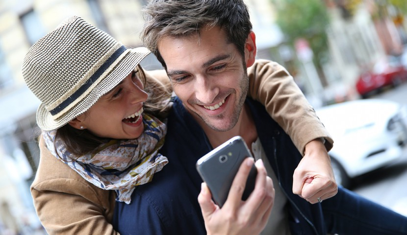 Couple looking at mobile phone together