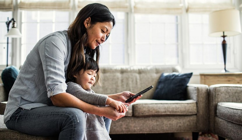 Woman and child on tablet device